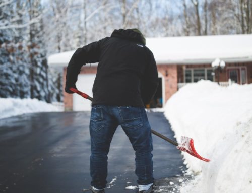 How to Protect Your Back While Shoveling Snow